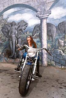 beautiful woman on a motorcycle